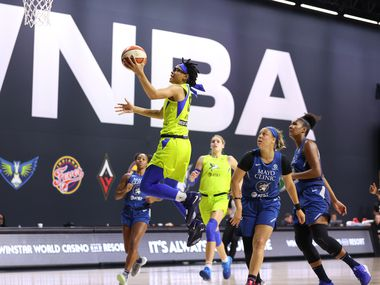 PALMETTO, FL - September 4: Allisha Gray #15 of the Dallas Wings shoots the ball against the Minnesota Lynx on September 4, 2020 at the Feld Entertainment Center in Palmetto, Florida. NOTE TO USER: User expressly acknowledges and agrees that, by downloading and/or using this Photograph, user is consenting to the terms and conditions of the Getty Images License Agreement. Mandatory Copyright Notice: Copyright 2020 NBAE