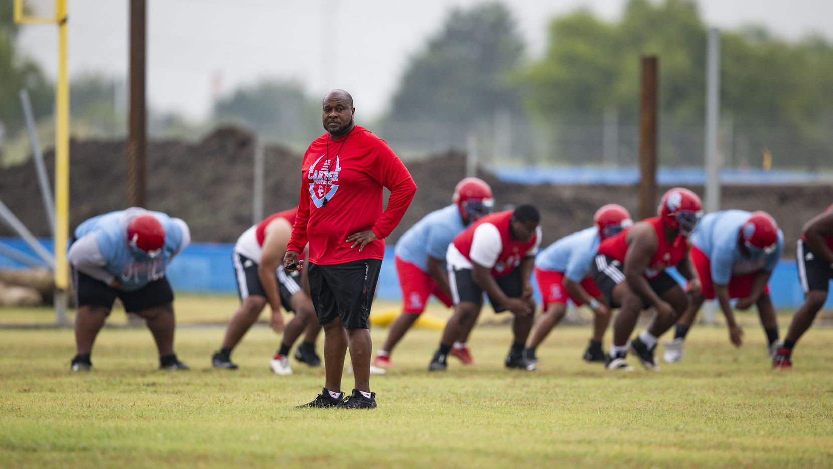 Carter head coach Spencer Gilbert watches his team during the first day of football practice at Carter High School in Dallas, Monday, August 2, 2021. (Brandon Wade/Special Contributor)