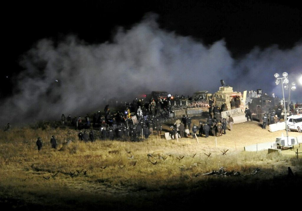 In this Nov. 20 photo provided by the Morton County Sheriff's Department, law enforcement and protesters clash near the site of the Dakota Access pipeline in Cannon Ball, N.D. (Morton County Sheriff's Department via AP, File)