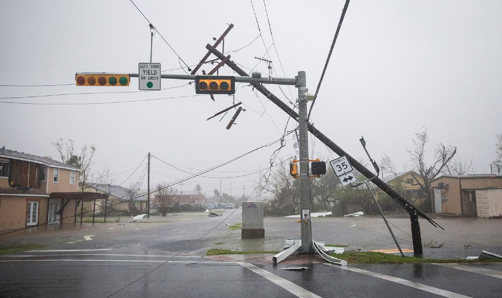 A snapped power pole leans against a stoplight after Hurricane Harvey ripped through Rockport, Texas, on Saturday.