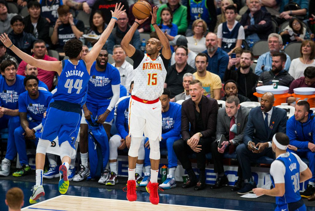 Atlanta Hawks guard Vince Carter (15) goes up for a shot against Dallas Mavericks forward Justin Jackson (44) during the third quarter of an NBA game between the Dallas Mavericks and the Atlanta Hawks on Saturday, February 1, 2020 at American Airlines Center in Dallas. (Ashley Landis/The Dallas Morning News)