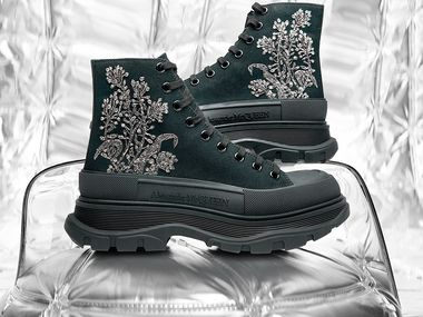 Alexander McQueen men's tread slick canvas embroidered boots are made in Italy and retail for $1,290. It's one of 11 exclusive sneakers in Neiman Marcus' first virtual showroom where people can shop. The showroom is on online men's contemporary fashion and streetwear site Hypebeast.
