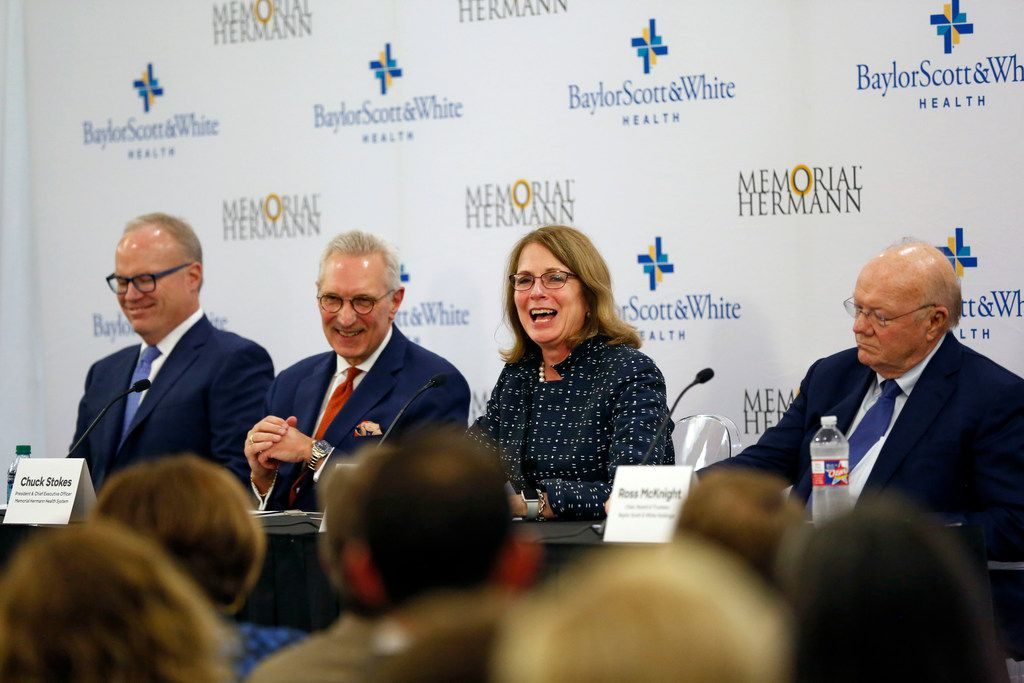 (Center right), Deborah Cannon, Memorial Hermann Health System Board of Directors chair, speaks as (left) Jim Hinton, Baylor Scott and White's CEO; (center left) Chuck Stokes, Memorial Hermann Health System's president and CEO, and Ross McKnight, Baylor Scott and White's board of trustees chair, listen during a press conference announcing the merger between Baylor Scott and White Health and Memorial Hermann Health System on Monday, October 1, 2018, at Baylor Charles A. Sammons Cancer Center in Dallas. (Daniel Carde/The Dallas Morning News)