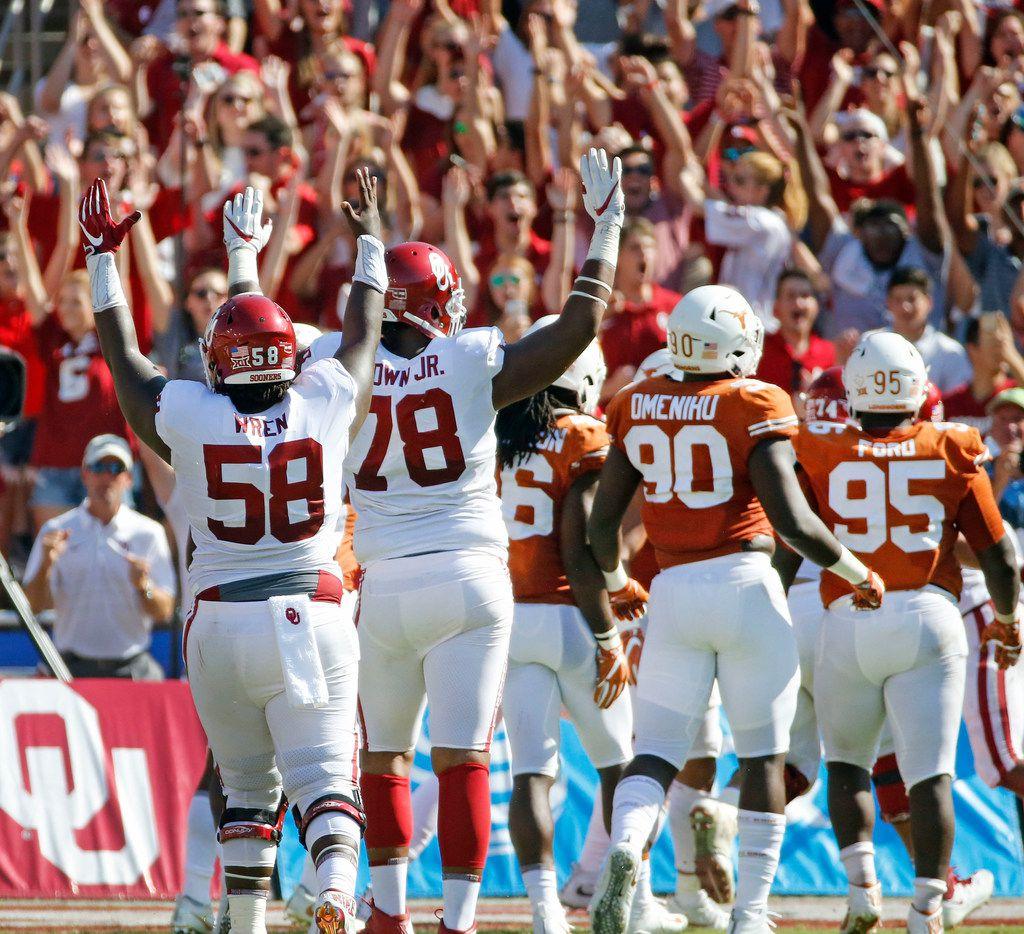 The Sooners celebrate a second quarter touchdown during the Oklahoma University Sooners vs. the University of Texas Longhorns NCAA college football game at the Cotton Bowl in Dallas on Saturday, October 14, 2017. (Louis DeLuca/The Dallas Morning News)