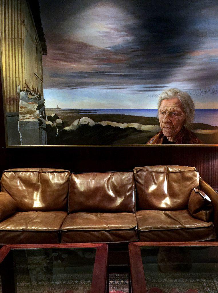 Artwork adorns the walls of the windowless bar at Hotel Holt, Reykjavík