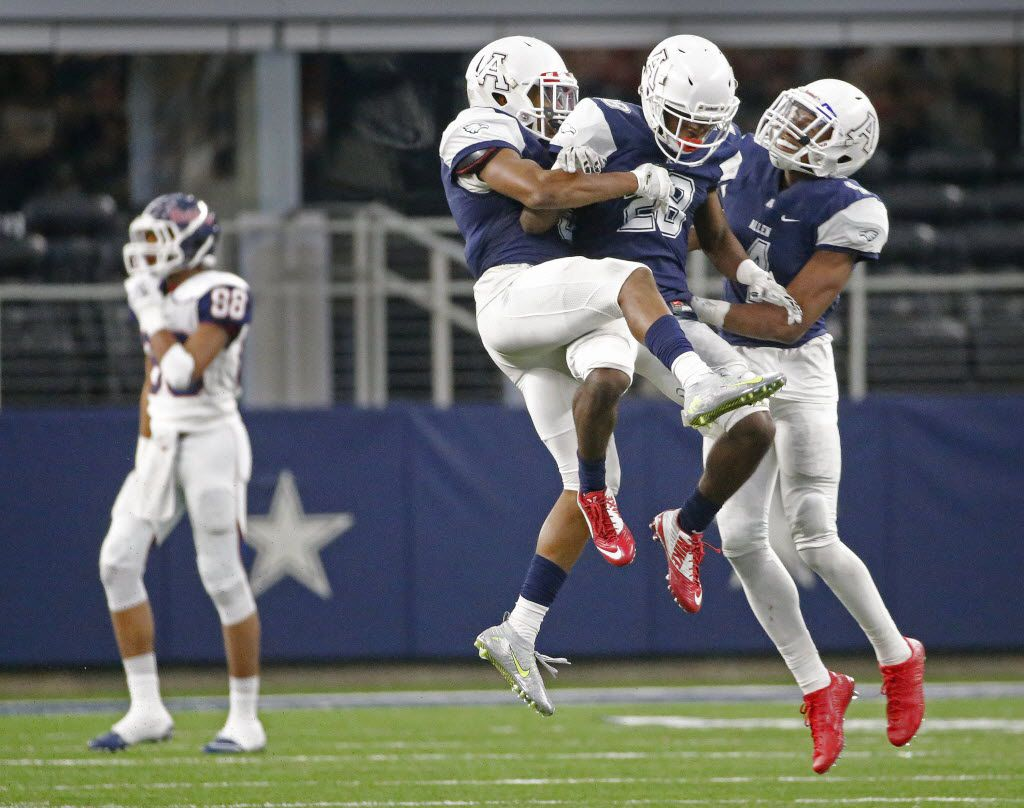 Allen defenders Anthony Taylor, Nick Allen and Jaylon Jones, left to right, celebrate taking the ball over on downs from Denton Ryan, as the Raiders Chritauskie Dove (88) walks to the bench in the fourth quarter during the Allen High School Eagles vs. the Denton Ryan High School Raiders playoff football game at AT&T Stadium in Arlington on Saturday, December 5, 2015. (Louis DeLuca/The Dallas Morning News)