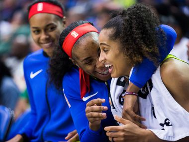 Forward Kayla Thornton (6) hugs Dallas Wings guard Skylar Diggins-Smith during the fourth quarter of a WNBA game between the Dallas Wings and the Indiana Fever on Thursday, July 5, 2018 at UTA's College Park Center in Arlington, Texas.