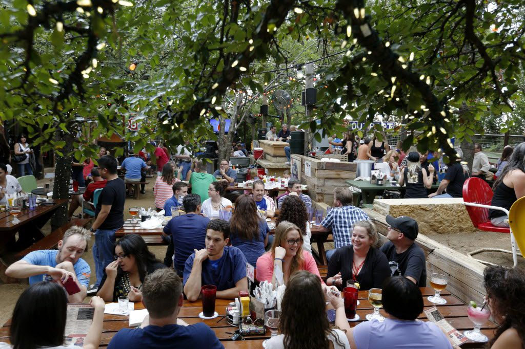 Groups enjoy the early evening on the patio at the Katy Trail Ice House Outpost.