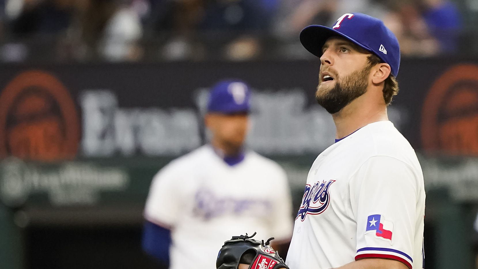 Texas Rangers pitcher Jordan Lyles reacts after a home run by San Diego Padres first baseman Eric Hosmer during the fourth inning at Globe Life Field on Saturday, April 10, 2021.