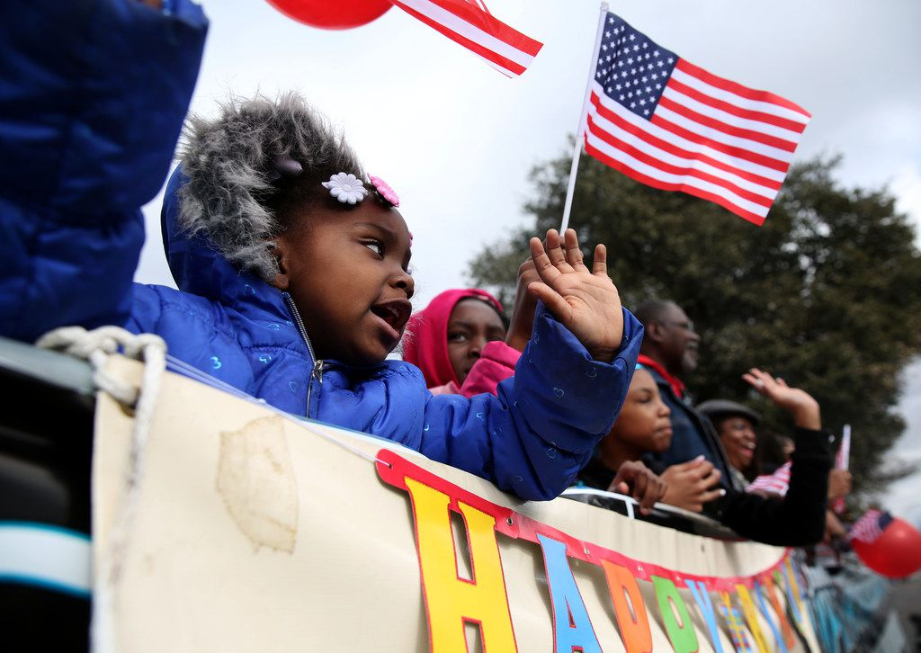 Eternity Wright, 3, waves during the Martin Luther King, Jr. Parade on Martin Luther King, Jr. Day in Dallas.