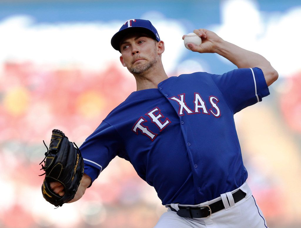 Texas Rangers starting pitcher Mike Minor (23) pitches in the first inning of play in a game against the Kansas City Royals at Globe Life Park in Arlington, Texas on Thursday, May 30, 2019. (Vernon Bryant/The Dallas Morning News)