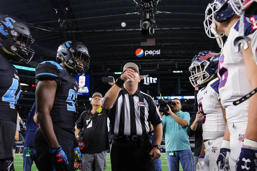 The coin toss before a Class 5A Division I state championship game between Denton Ryan and Alvin Shadow Creek at the AT&T Stadium in Arlington, on Friday, December 20, 2019. Shadow Creek leads at halftime 14-8. (Juan Figueroa/The Dallas Morning News)