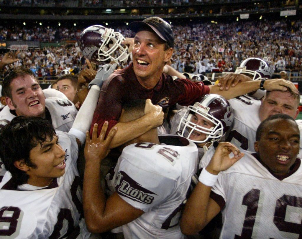 Houston, Texas -  Ennis head coach Sam Harrell is lifted by his players as he watches the clock tic down on their way to beat Bay City  21-0 for the 4A Div II UIL state football championship at the Houston Astrodome Saturday. The Dallas Morning News.