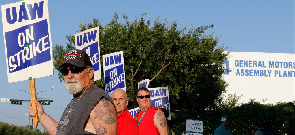 Retired GM worker Jeff Adler, left, came out to picket with other General Motors Assembly Plant workers on the picket lines early Monday morning, September 16, 2019, at the GM plant in Arlington, Texas.
