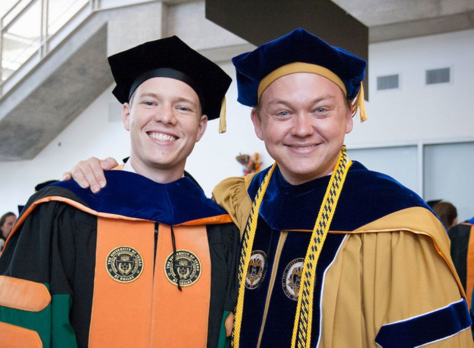 Researcher Jonathan Reeder poses with his doctoral adviser, Walter Voit.