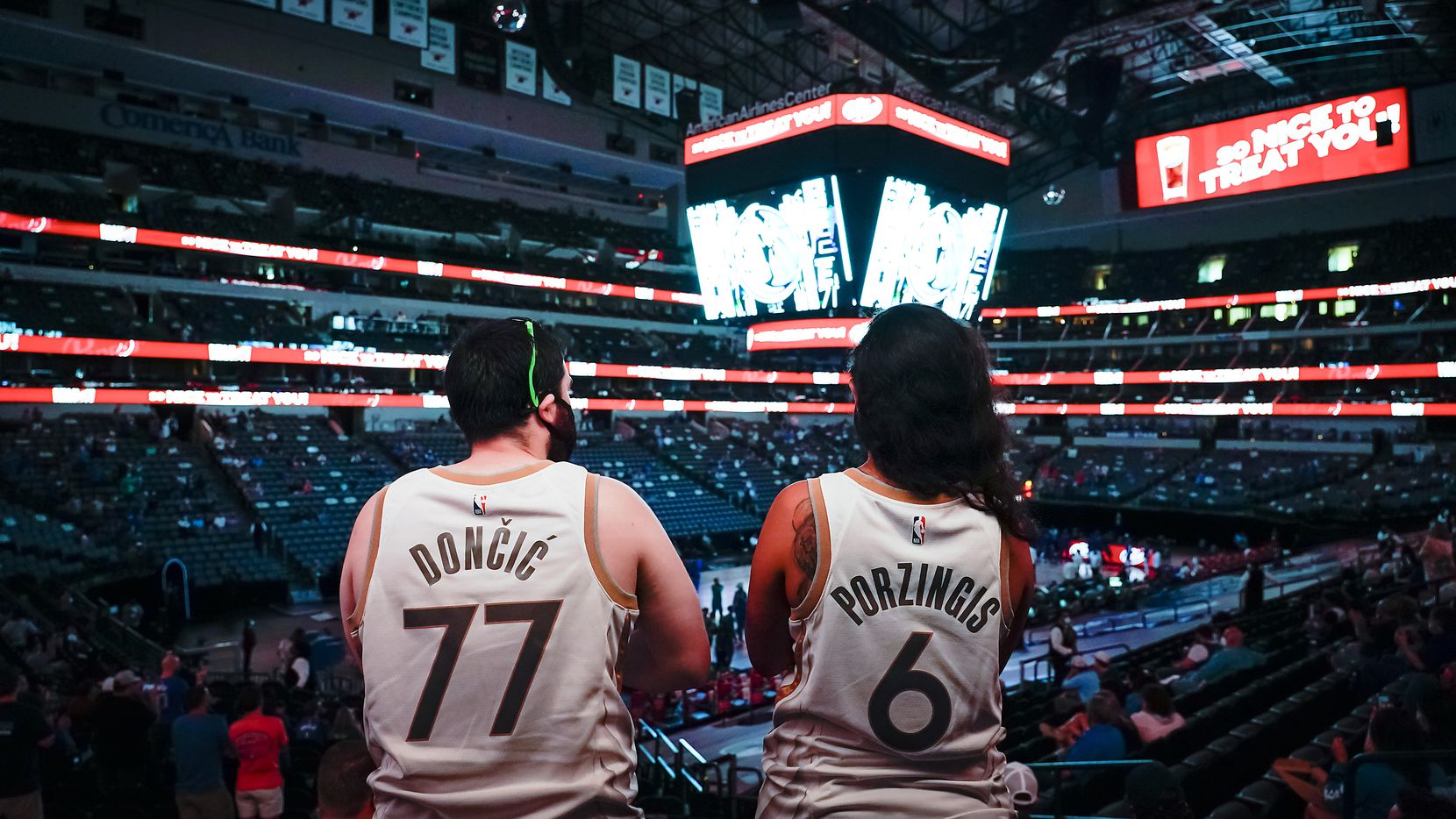 Fans wearing the jerseys of Dallas Mavericks guard Luka Doncic and Kristaps Porzingis cheer as the team is announced before an NBA basketball game against the Sacramento Kings at American Airlines Center on Sunday, May 2, 2021, in Dallas.