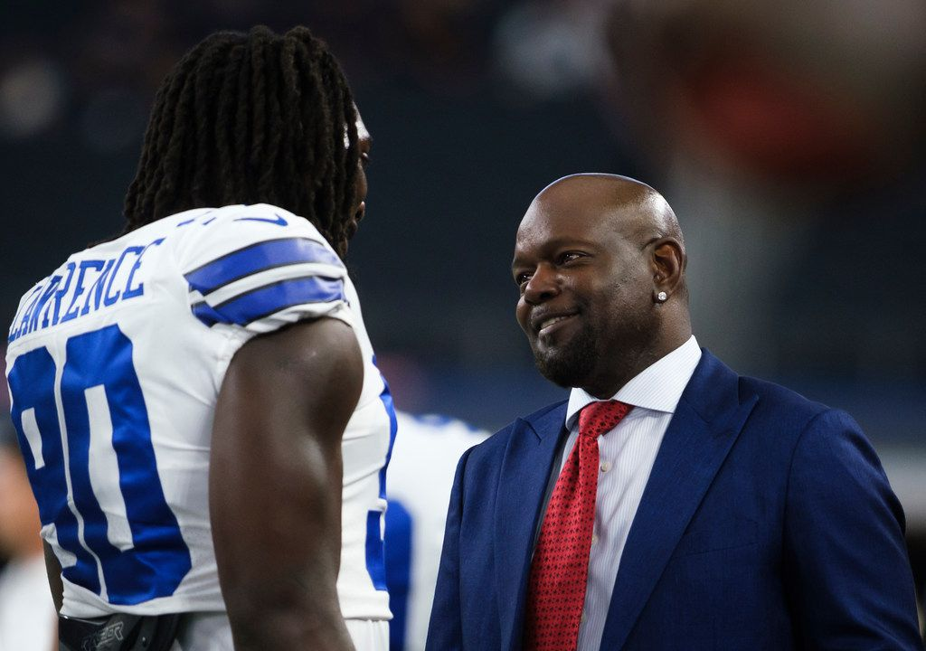 Dallas Cowboys defensive end Demarcus Lawrence (90) chats with Emmitt Smith as the teams warm up before an NFL preseason football game against the Tampa Bay Buccaneers at AT&T Stadium on Thursday, Aug. 29, 2019, in Arlington. (Smiley N. Pool/The Dallas Morning News)