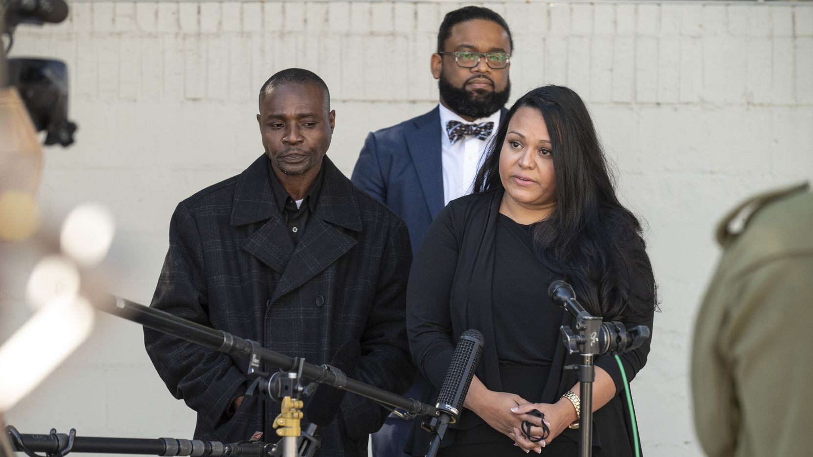 Attorney Larry Taylor, background, listens to Timonthy Matts, left, and Vanessa Calderon, right, the parents of Deja and Abbaney Matts, speak about their lawsuit against Texas A&M University-Commerce after their daughters were killed in a dorm room in February, on Tuesday, Dec. 08, 2020 in Dallas.