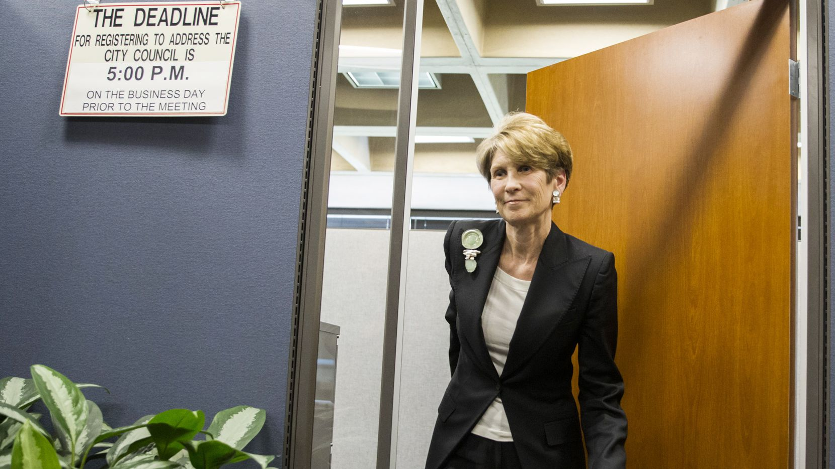 Former Dallas Mayor Laura Miller speaks to reporters at City Hall as she leaves the city secretary's office after filing the required petition signatures to secure a place on the ballot for Dallas City Council District 13.