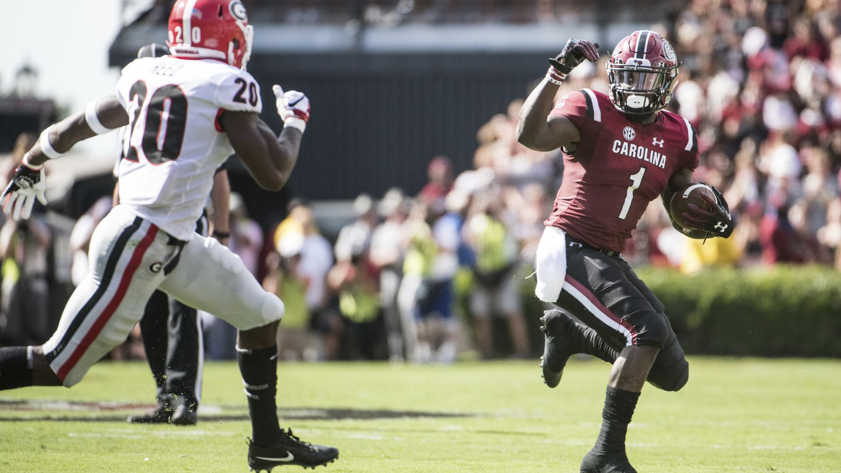 South Carolina wide receiver Deebo Samuel (1) runs with the ball against Georgia defensive back J.R. Reed (20) during the second half of an NCAA college football game Saturday, Sept. 8, 2018, in Columbia, S.C. Georgia defeated South Carolina 41-17. (AP Photo/Sean Rayford)