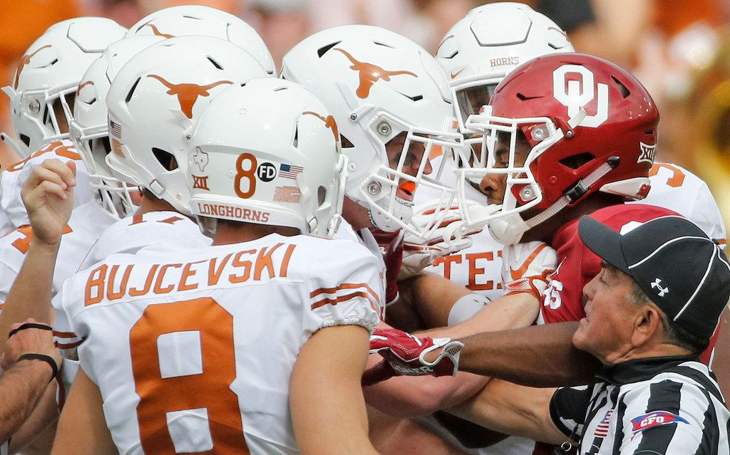 Oklahoma Sooners cornerback Tre Brown (6) mixes it up with a host of Texas players during the University of Texas Longhorns vs. the Oklahoma Sooners NCAA football game at the Cotton Bowl in Dallas on Saturday, October 6, 2018. (Louis DeLuca/The Dallas Morning News)