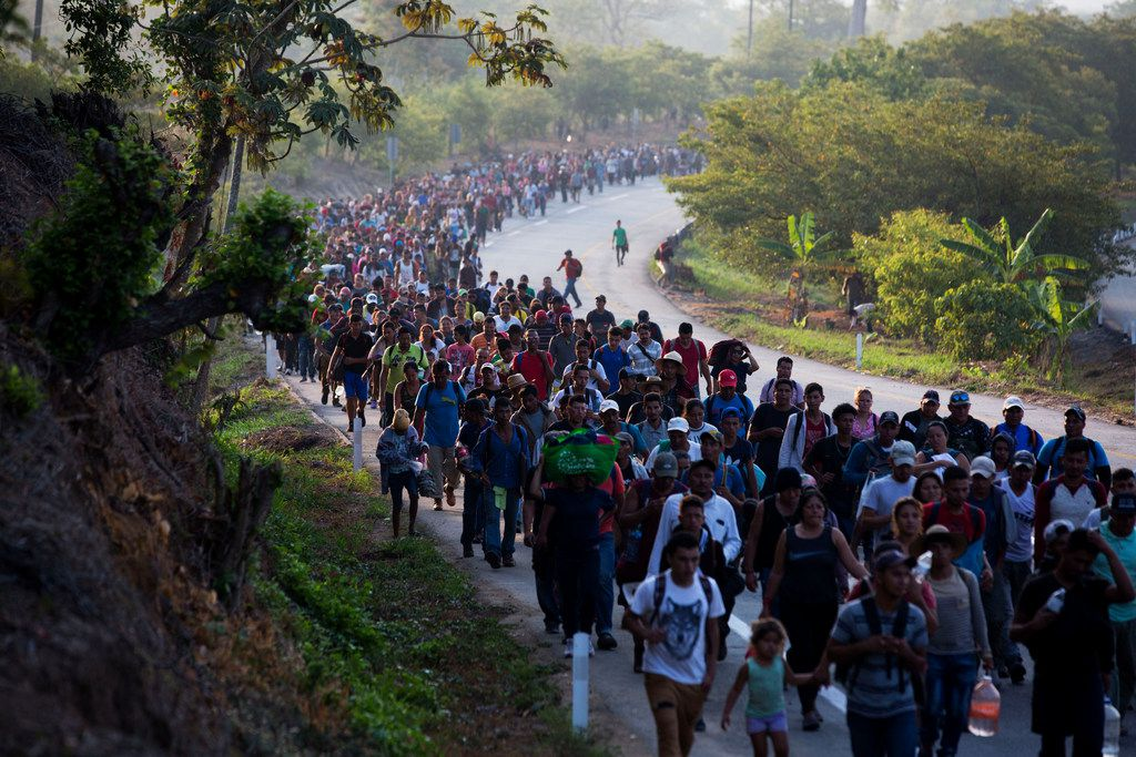 In this April 20, 2019, file photo, Central American migrants, part of a caravan hoping to reach the U.S. border, move on the road in Escuintla, Chiapas state, Mexico. The number of migrants apprehended at the Southern border topped 100,000 for the second month in a row, as the Trump administration manages an ever increasing number of Central American families streaming to the U.S.