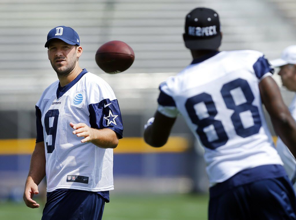 Dallas Cowboys wide receiver Dez Bryant (88) tosses the ball back to quarterback Tony Romo (9) during the morning walk-thru at training camp in Oxnard, California, Saturday, July 30, 2016. (Tom Fox/The Dallas Morning News)