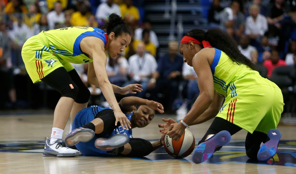 Minnesota Lynx guard Renee Montgomery (21) loses the ball against Dallas Wings guard Saniya Chong (12) and Dallas Wings forward Kayla Thornton (6) in the third quarter at College Park Center in Arlington, Texas on Saturday, May 20, 2017. The Dallas Wings lost to the Minnesota Lynx 89-87. (Rose Baca/The Dallas Morning News)