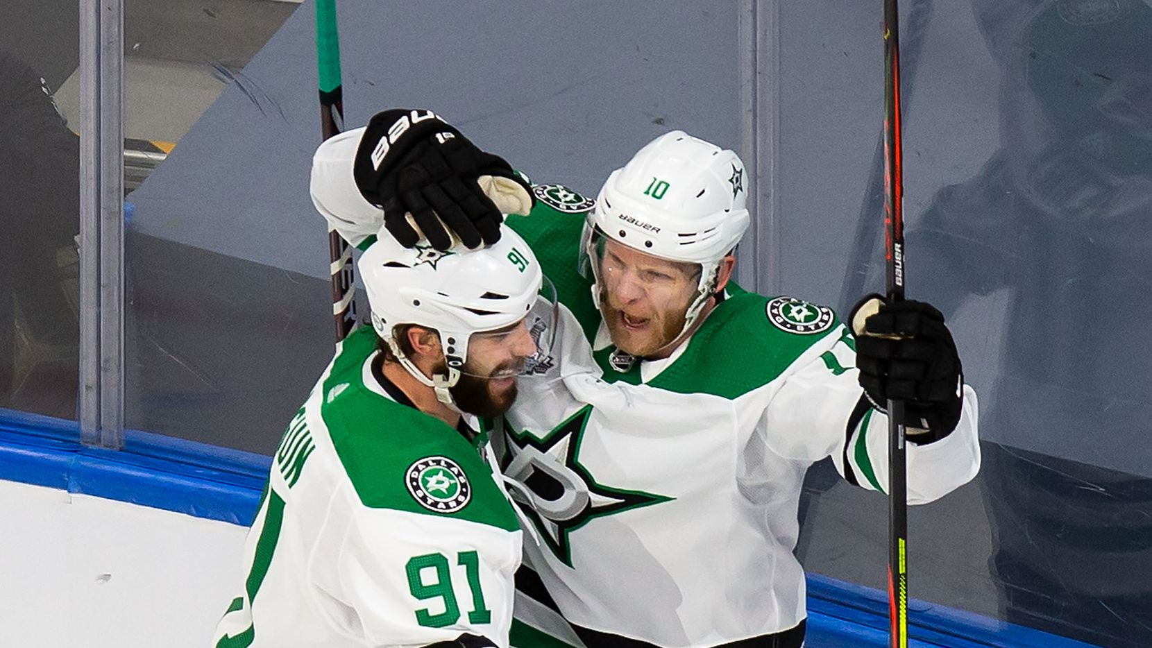 Tyler Seguin (91), Corey Perry (10) and Joel Kiviranta (25) of the Dallas Stars celebrate Perry's goal against the Tampa Bay Lightning during Game Five of the Stanley Cup Final at Rogers Place in Edmonton, Alberta, Canada on Saturday, September 26, 2020. (Codie McLachlan/Special Contributor)