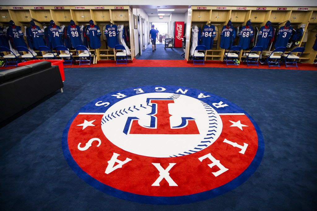 FILE - The team logo fills the center of the room in the clubhouse of the Texas Rangers' spring training facility as seen during a media tour on Thursday, Feb. 18, 2016, in Surprise, Ariz. (Smiley N. Pool/The Dallas Morning News)