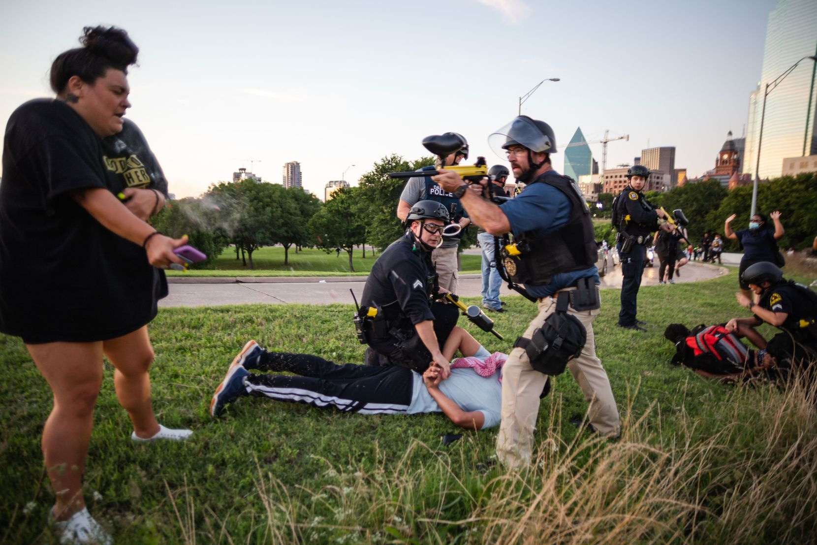 Jantzen Verastique recoils from a pepper ball fired by Dallas police Sgt. Roger Rudloff during George Floyd protests last year.