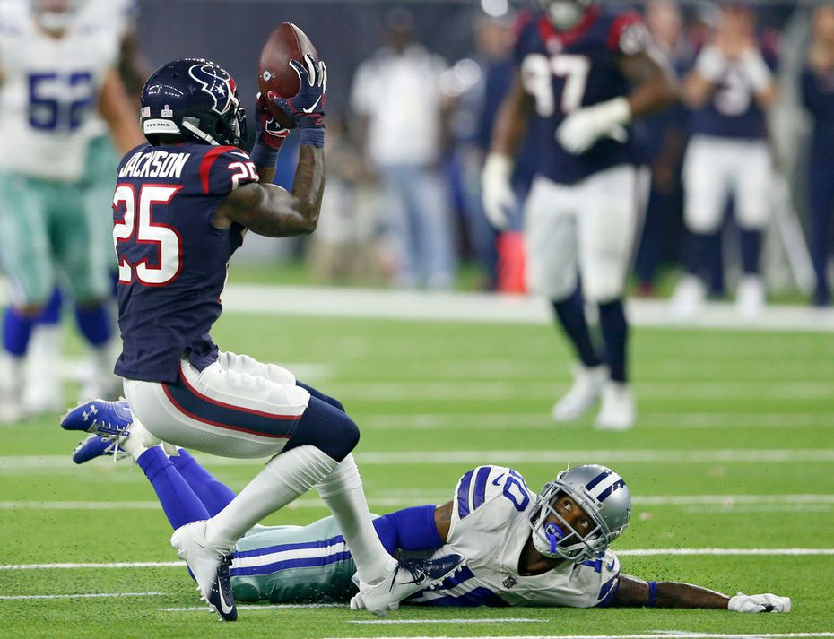 Houston Texans strong safety Kareem Jackson (25) intercepts a pass intended for Dallas Cowboys wide receiver Tavon Austin (10) during the first half of play at NRG Stadium in Houston on Sunday, October 7, 2018. (Vernon Bryant/The Dallas Morning News)