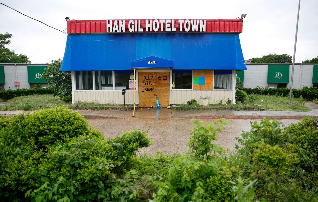 The exterior of the Han Gil Motel on Wednesday, May 1, 2019, in Dallas. The motel was shut down after being raided by federal authorities in early March.