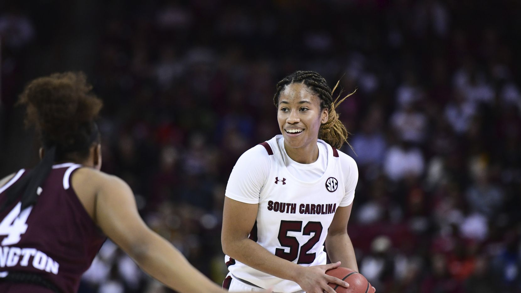 South Carolina guard Tyasha Harris (52) is defended by Texas A&M guard Shambria Washington (4) during the first half of an NCAA college basketball game Sunday, March 1, 2020, in Columbia, S.C. South Carolina defeated Texas A&M 60-52.