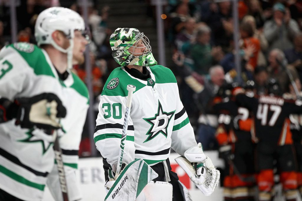 ANAHEIM, CA - DECEMBER 12:  Ben Bishop #30 of the Dallas Stars looks on after a goal scored by Brandon Montour #26 of the Anaheim Ducks during the third period of a game at Honda Center on December 12, 2018 in Anaheim, California.  (Photo by Sean M. Haffey/Getty Images)