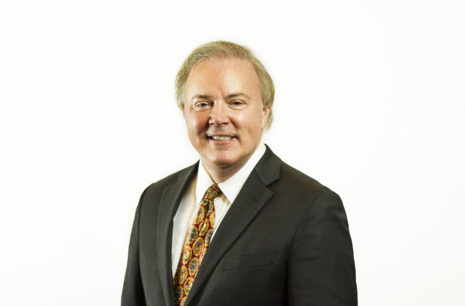 Ron Woessner, the fired CEO of COPsync, still sits on the board of directors.