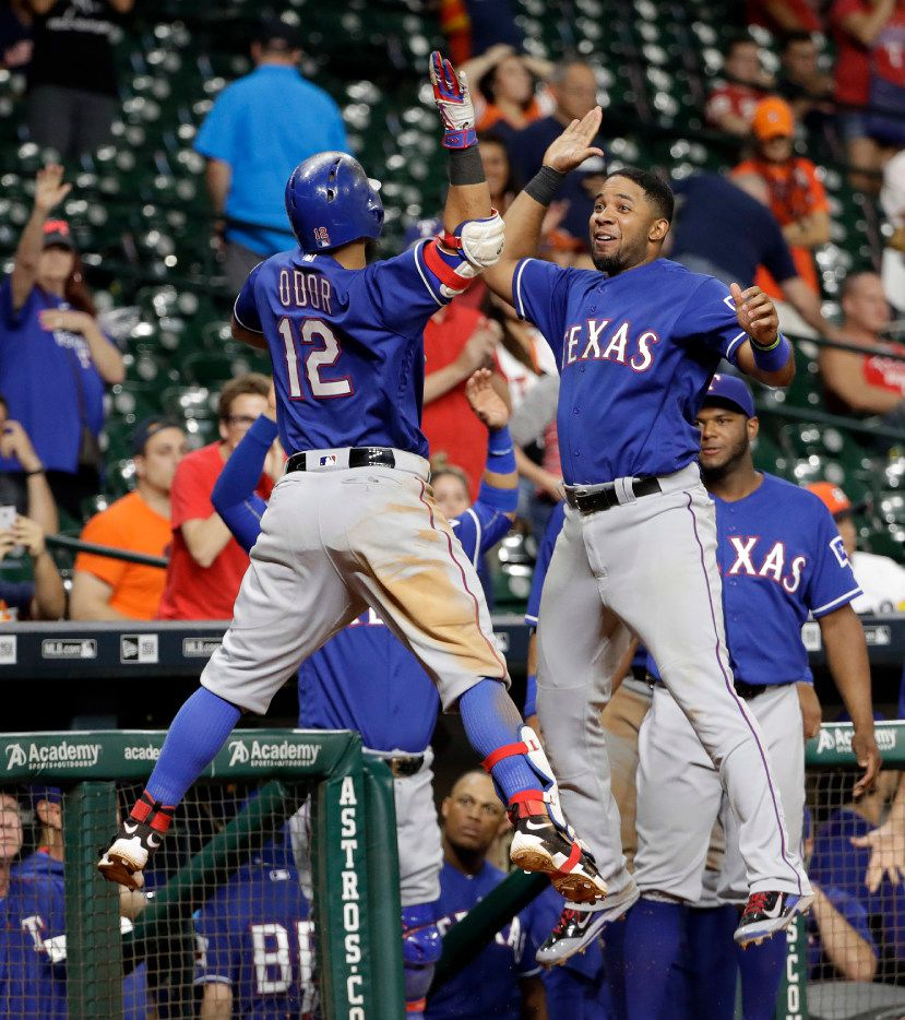 Texas Rangers' Rougned Odor (12) celebrates with Elvis Andrus, right, after hitting a home run against the Houston Astros during the 12th inning of a baseball game, Monday, Sept. 12, 2016, in Houston. (AP Photo/David J. Phillip)