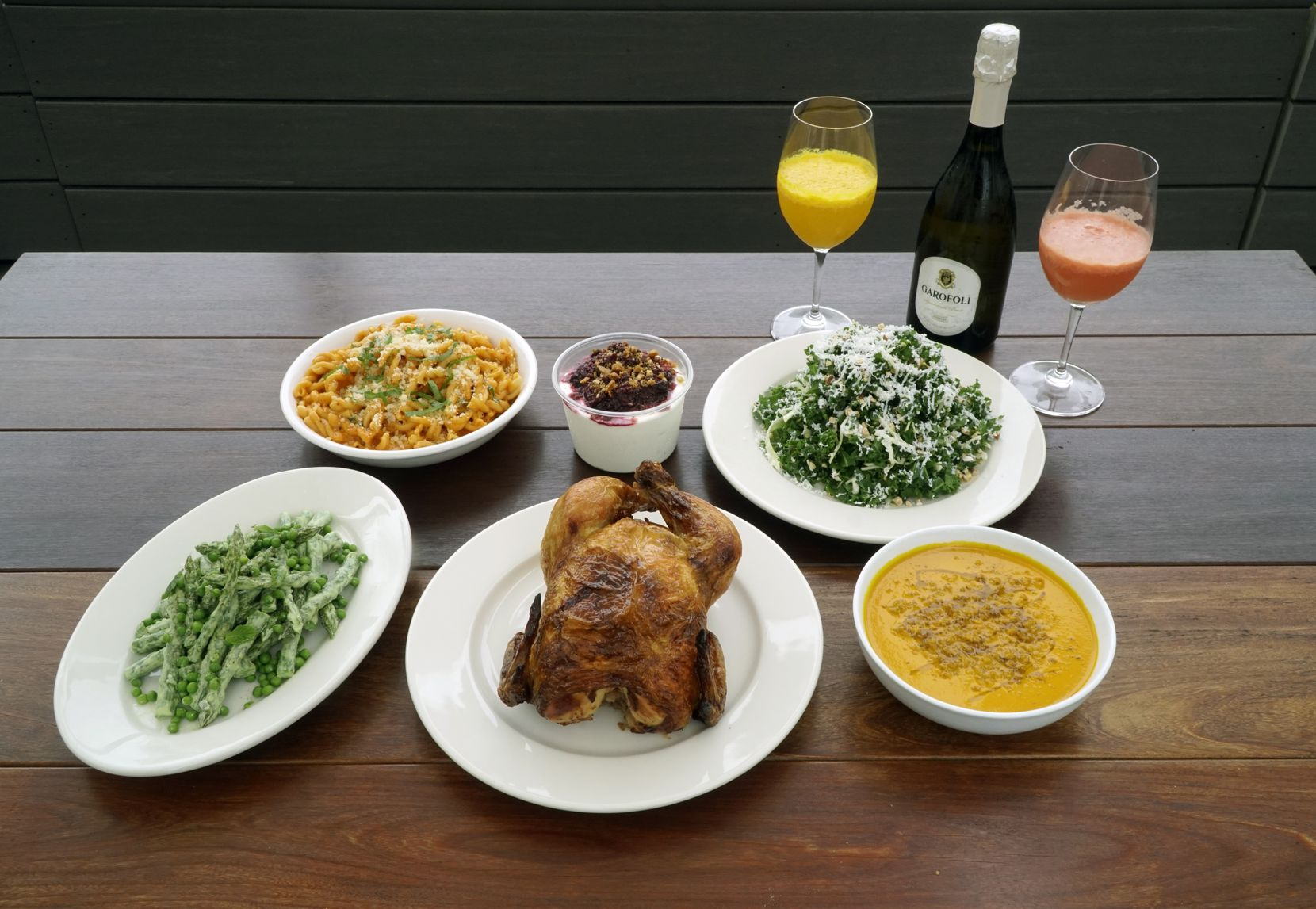Mother's Day dinner at il Braccoo in Dallas on April 22, 2020. The dinner includes chilled carrot soup, kale salad, roasted whole chicken, asparagus and peas, panna cotta, and a mimosa kit.
