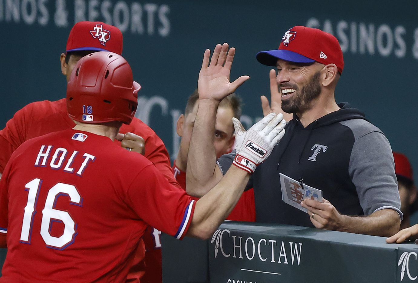 Texas Rangers batter Brock Holt (16) is congratulated by manager Chris Woodward after hitting a solo home run against the Houston Astros in the third inning at Globe Life Field in Arlington, Texas, Friday, May 21, 2009. (Tom Fox/The Dallas Morning News)