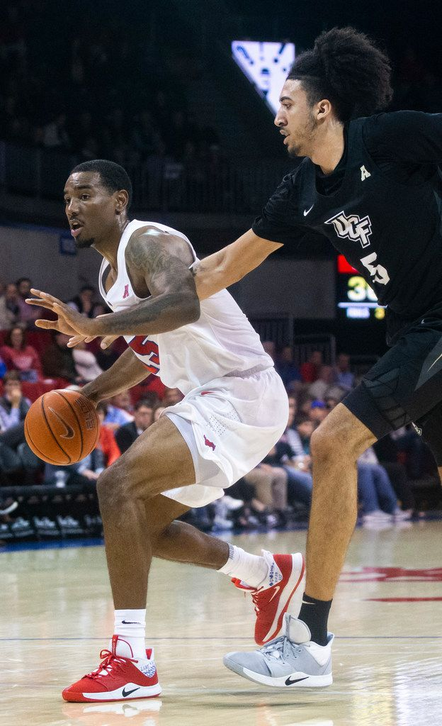 Southern Methodist Mustangs forward Isiaha Mike (15) tries to maneuver past UCF Knights center Avery Diggs (5) in the first half of an NCAA basketball game between the SMU Mustangs and the University of Central Florida Knights at Moody Coliseum in University Park, Texas, on Wednesday, Jan. 8, 2020.