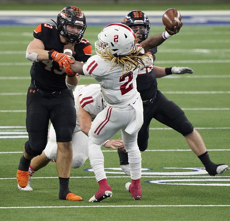 Crosby Deniquez Dunn (2) tries to pass under pressure from Aledo defensive lineman Kyle Thompson (43) during the first half of the Class 5A Division II state football championship game at AT&T Stadium on Friday, Jan. 15, 2021, in Arlington. (Smiley N. Pool/The Dallas Morning News)