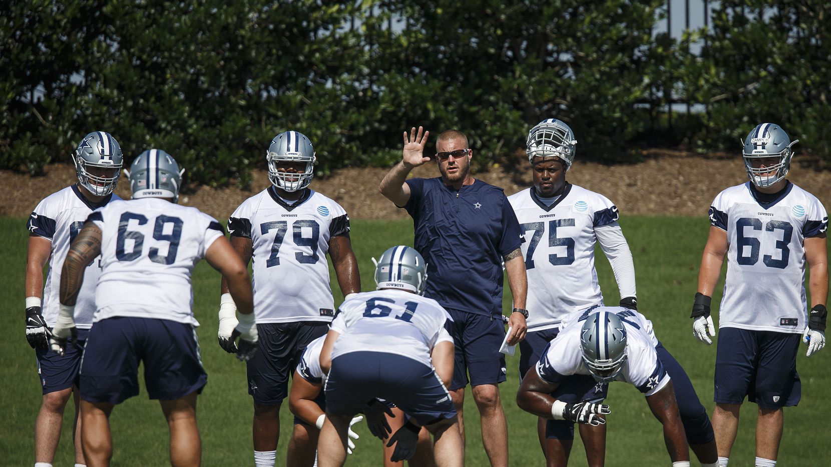 Dallas Cowboys assistant offensive line coach Marc Colombo works with lineman during the third and final round of Cowboys OTA practices at The Star on Wednesday, June 6, 2018, in Frisco.