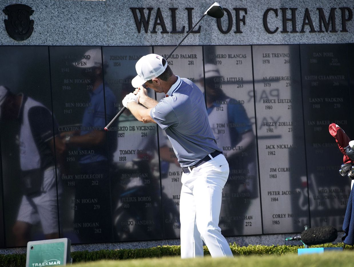 PGA Tour golfer Justin Rose uses the reflection in the Wall of Champions to study his swing during the opening round of the Charles Schwab Challenge at the Colonial Country Club in Fort Worth, Thursday, June 11, 2020.  The Challenge is the first tour event since the COVID-19 pandemic began. (Tom Fox/The Dallas Morning News)