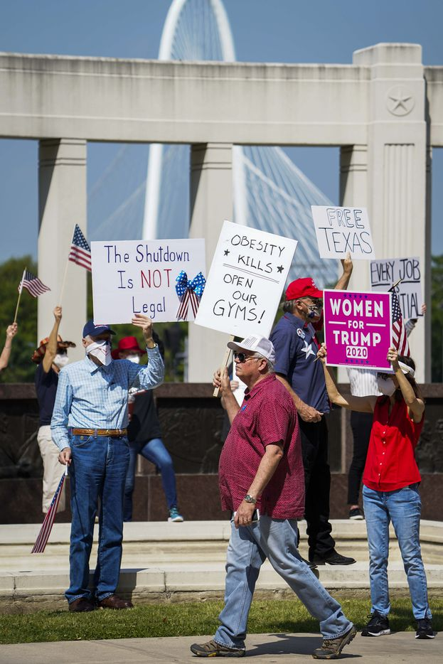 Protesters rally against government stay-at-home orders at Dealey Plaza on Tuesday, April 21, 2020, in Dallas.