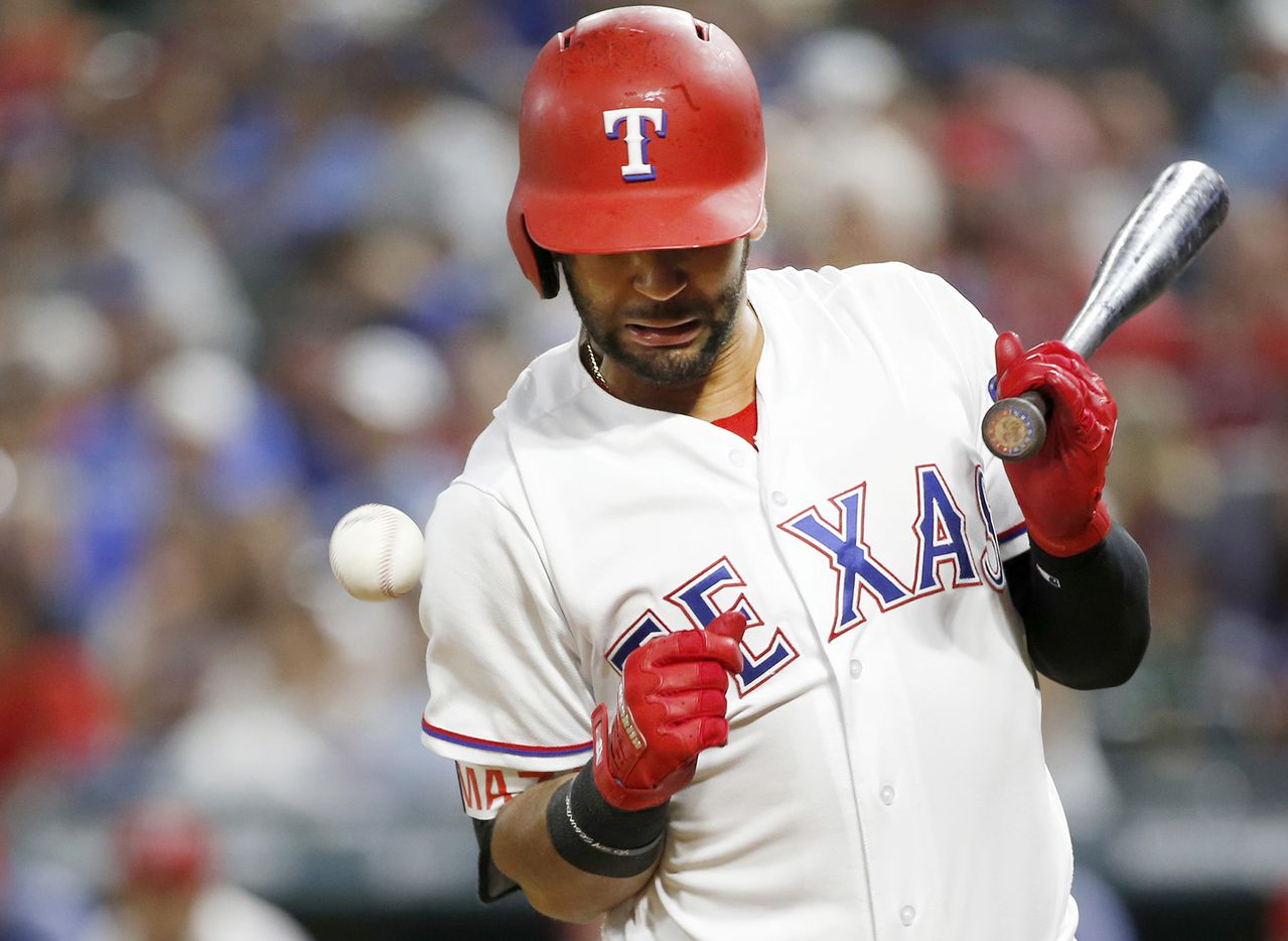 Rangers right fielder Nomar Mazara gets hit by a pitch from San Diego Padres relief pitcher Brad Hand on May 10 at Globe Life Park. The Rangers won 4-3.