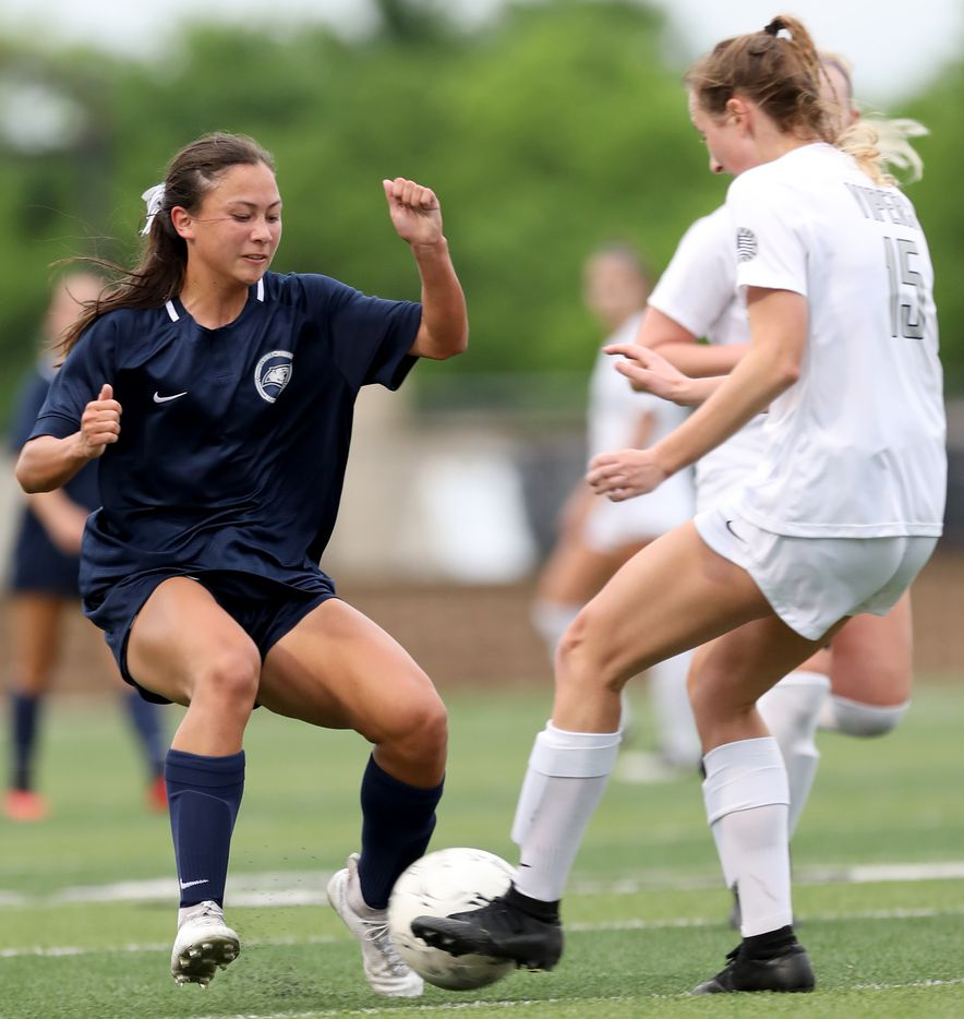 Lewisville Flower Mound's Emma Hoang (23) and Austin Vandegrift's Evan Ormond (15) struggle for control of the ball during their UIL 6A girls State championship soccer game at Birkelbach Field on April 16, 2021 in Georgetown, Texas. (Thao Nguyen/Special Contributor)