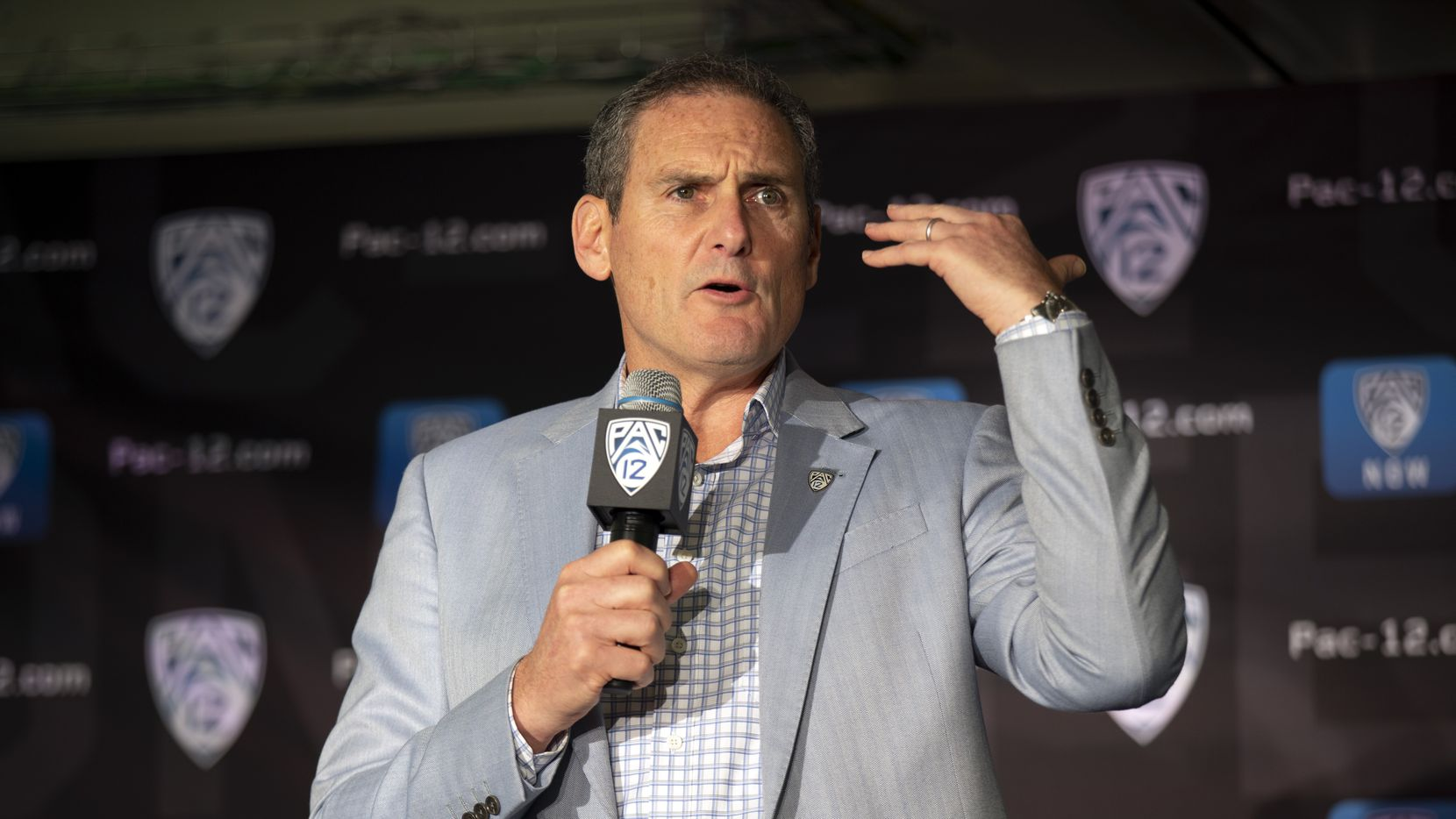 """FILE - In this Oct. 8, 2019, file photo, commissioner Larry Scott speaks during the Pac-12 NCAA college basketball media day, in San Francisco. The commissioners of the Atlantic Coast Conference, Big Ten, Big 12, Pac-12 and Southeastern Conference say they have been in almost constant contact since the NCAA men's basketball tournament was canceled on March 12."""" Based on the very positive and close collaboration among the leaders in college football and discussions with schools, other leagues and the medical community, at this point in time we are planning to start the football season on time and together on a national basis,"""" Pac-12 Commissioner Larry Scott said."""