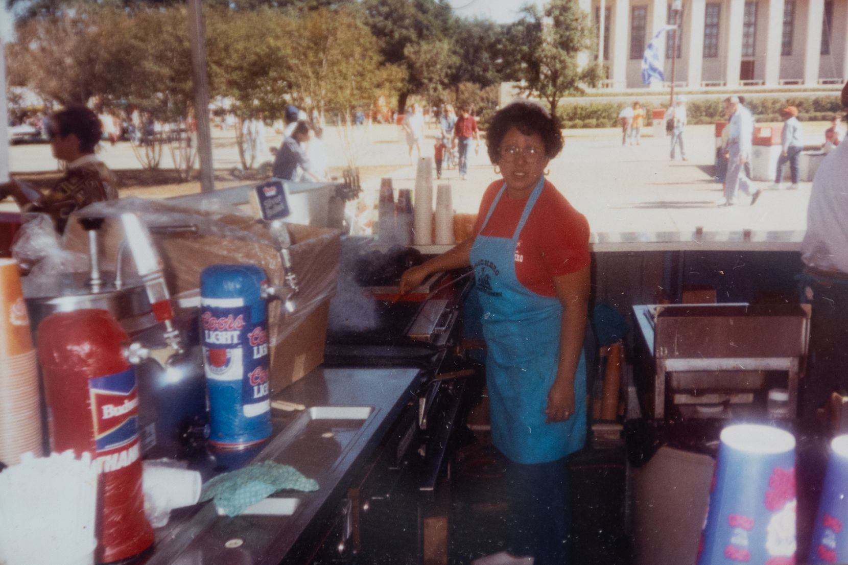 A photo from the early 1990s at the State Fair of Texas of Denise Garza de la Cruz, daughter of Benilde Garza, who first opened the Garza family food booth, at the State Fair of Texas in Dallas, shown on Sept. 30, 2021.