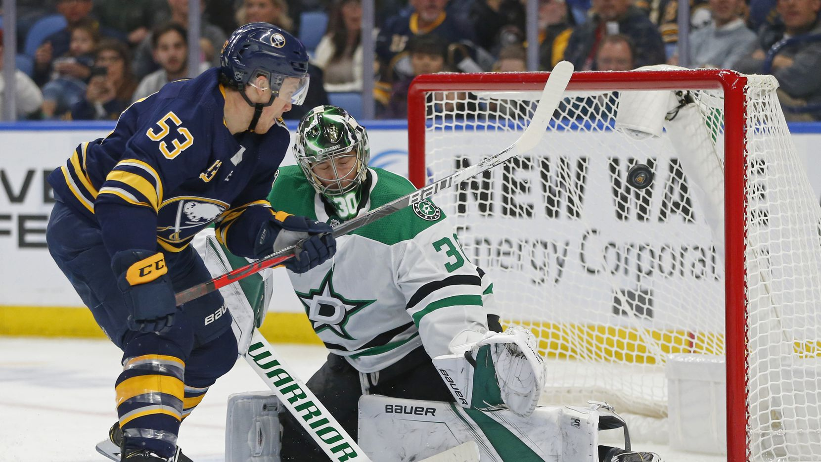 Buffalo Sabres forward Jeff Skinner (13) scores on Dallas Stars goalie Ben Bishop (30) during the third period of an NHL hockey game, Monday, Oct. 14, 2019, in Buffalo N.Y.