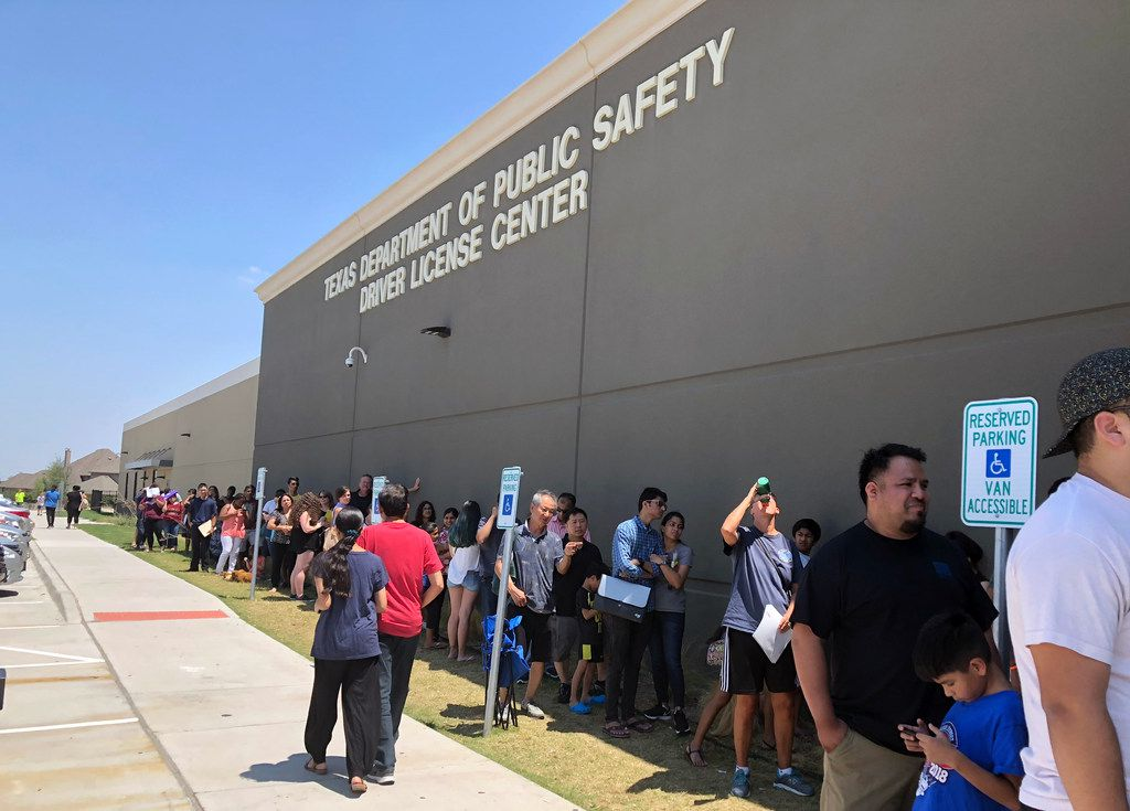 Long lines form at the Texas Department of Public Safety Driver License Mega Center in Carrollton, on Friday, Aug. 3, 2018.